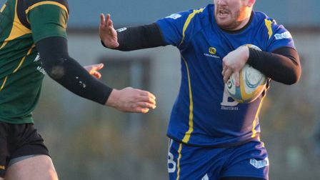 Paul Ashbridge shrugs off an opponent as St Ives beat Vipers. Picture: PAUL COX