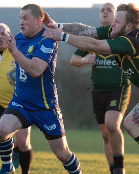 Mickey Drake dodges a Vipers player while helping St Ives to victory. Picture: PAUL COX