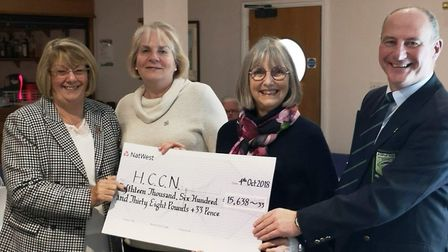 A cheque for more than £15,000 was handed over to HCCN. Picture: CONTRIBUTED