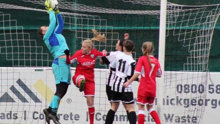 St Ives Town Ladies goalkeeper Kira Markwell claims a cross against Acle United. Picture: GARY REED