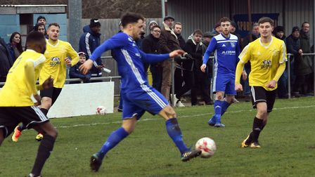 Chris Hyem in action for Godmanchester Rovers in their FA Vase fifth round clash with Sporting Khals