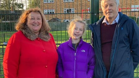 Parish councillors Derrick Crump and Cecilia Hathaway with Indiana May Evans at the opening of Roest