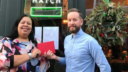 Manager Liam Judge handing over the cheque to Rephael House Counselling Centre. Picture: Liam Judge