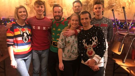 The staff at Hatch wearing Christmas jumpers to raise awareness of their donation day. Picture: Liam