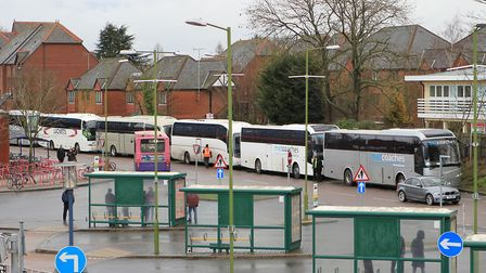 Rail replacement coaches lined up in the bus layover bay on Station Way, across from St Albans City