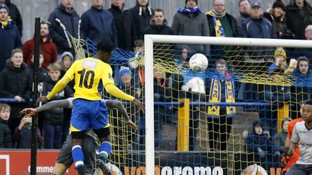 David Moyo rises at the back post to head towards goal. Picture: LEIGH PAGE
