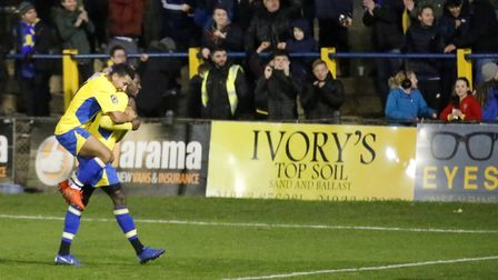 Zane Banton celebrates with David Moyo after the Saints' late winner. Picture: LEIGH PAGE