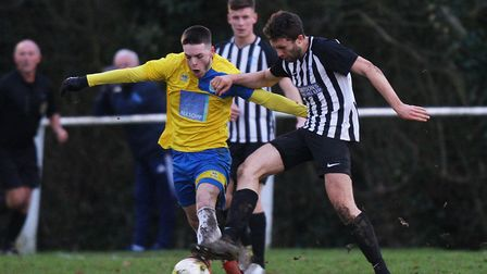 Harpenden Town V Colney Heath - Jake Davis for Harpenden Town battles with Andy Sears-Black for Coln