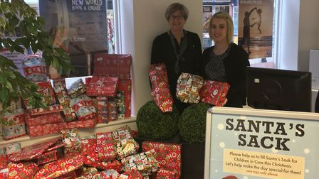 Staff with the gifts at Premier Travel in Huntingdon