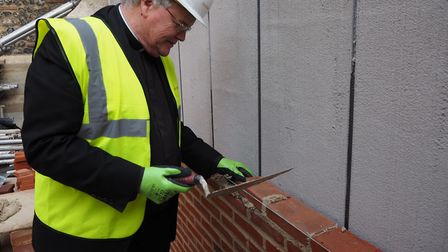 Very Reverend Dr Jeffrey John laying bricks for the new Vestry. Picture: Submitted by St Albans Cath