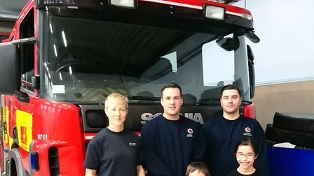 Fire crew members at St Alban Fire Station are presented with 'thank-you' cupcakes on Christmas Day
