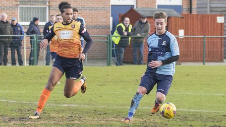 St Neots Town players past and present as Lewis Wilson tracks Johnny Herd. Picture: CLAIRE HOWES