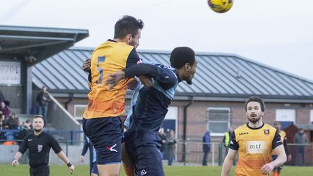 Nabil Shariff in an aerial duel as St Neots Town lost to Stratford Town. Picture: CLAIRE HOWES