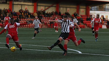 Jake Newman puts St Ives Town ahead in their victory at Tamworth. Picture: GEMMA THOMPSON