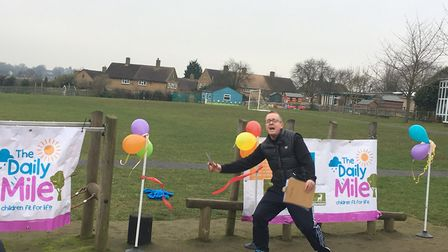 Sauncey Wood Primary School headteacher Steve Lloyd opening the Daily Mile running track. Picture: F