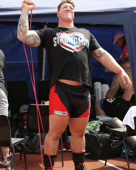 A competitor warms up behind the scenes at the UK's Strongest Man event held in Westminster Lodge. P