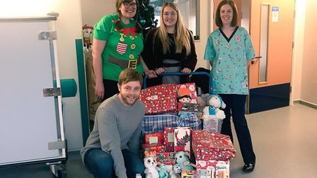 Staff at the Holly Ward in Huntingdon receiving the donations from the Hunts Post