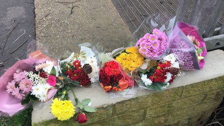 Floral tributes at Loves Way, in St Neots