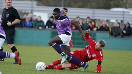 Percy Kiangebeni skips over the challenge of Jordan Parkes. Picture: LEIGH PAGE