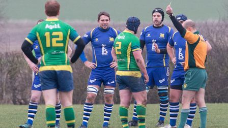 Huntingdon skipper Roger Shakespeare is yellow-carded during their loss at St Ives. Picture: PAUL CO