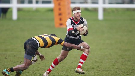 Harpenden look to avoid a tackle. Picture: DANNY LOO