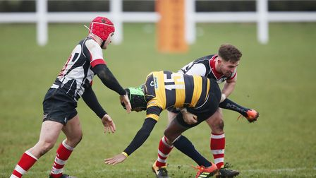 Harpenden combine in the tackle to stop a Letchworth attack. Picture: DANNY LOO