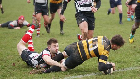 A desparing Harpenden dive misses as Letchworth number 10 goes over to score. Picture: DANNY LOO