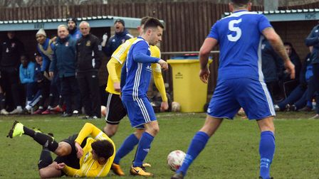 Godmanchester Rovers full-back Reece King comes away with the ball against Sporting Khalsa. Picture: