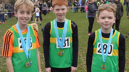 The triumphant Under 11 Boys team from Hunts AC are, from the left, Tom Richards, Alasdair Large and