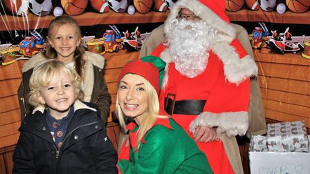 Georgia and Joel met Father Christmas and one of his elves at the Melbourn event. Picture: Clive Por