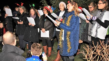 The Crescendo Choir and pupils from Melbourn Primary School sang carols at the Turn on to Chirstimas