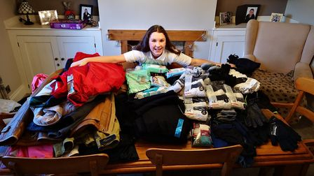 Lucy Giles with just some of the donated items. Picture: CONTRIBUTED