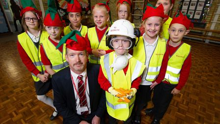 Barry Gibson from Redrow Homes give an 'Elf and Safety' talk to pupils from Alconbury C of E Primary