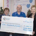 Irene Casper (left) and Dreda Gordon (right) hand a cheque over to Mount Vernon Cancer Care Charitab
