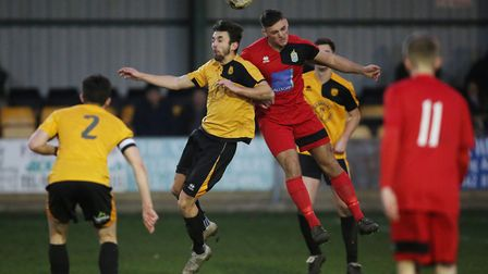 Josh Miles and Max Ashton compete in the air in the match between Stotfold v Harpenden Town. Picture