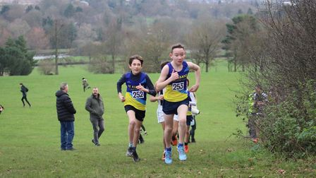 St Albans Athletics Club's Alex McDonald, winner of the U13 race, with Oscar Loveday at the Herts Cr