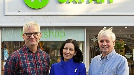Geoffrey Stalker, Andrea Skodackoua and Cllr Steve Mcadam outside Oxfam Books and Music in Huntingdo