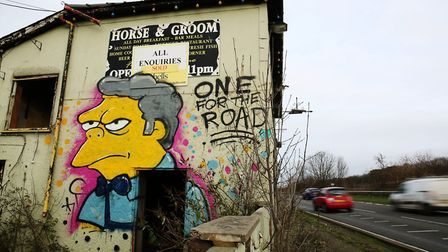 Bartender Moe from The Simpsons has been sprayed on to the side of the derelict Horse & Groom pub of