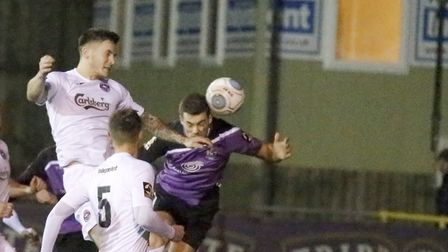 Michael Clark beats the Truro defence to direct a header towards goal. Picture: LEIGH PAGE