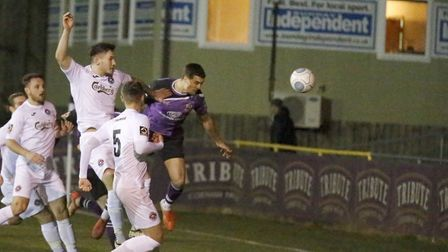 Michael Clark sends a header towards goal in the opening minutes. Picture: LEIGH PAGE