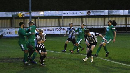 Charlie De'Ath heads the St Ives Town winner as they came from behind to beat Hitchin in the Souther
