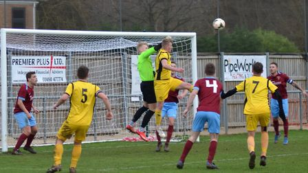 Action from the Hunts Intermediate Cup semi-final clash between Eaton Socon and Hemingfords United.