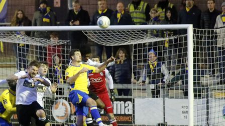 Michael Clark gets up to meet the ball. Picture: LEIGH PAGE