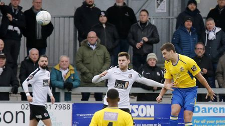 Michael Clark heads the ball clear. Picture: LEIGH PAGE