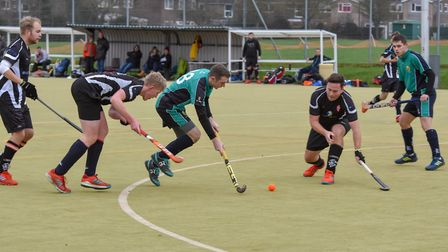 Rory Mooney on the ball for St Ives 1sts as Adam Maltby (far right) looks on. Picture: J BIGGS PHOTO