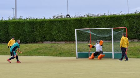 Darren Coles tucks away a penalty stroke in St Ives Men's 1sts' success against Bourne Deeping 2nds.