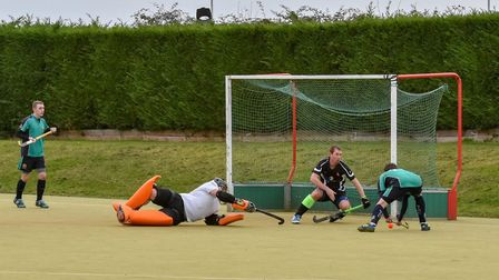 Goalmouth action as St Ives Men's 1sts go on the attack in their win against Bourne Deeping 2nds. Pi