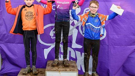 Verulam Reallymoving's Alarik Knox stands on top of the U10 podium in the Central Cyclo-cross League