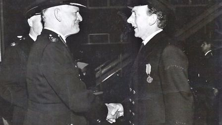 Tony Bowers was presented with a long-servic medal