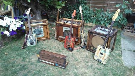 Moonshine Coyote play on guitars made of cigar boxes